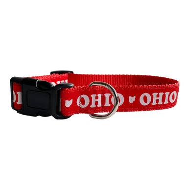 "Red dog collar with black buckle and silver loop with ""OHIO"" and an Ohio icon in white repeating around the collar."