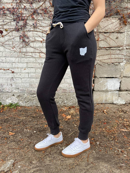 Lauren wearing black sweatpants with white Ohio icon.