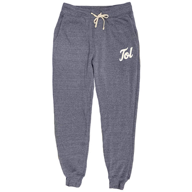 "Washed heather navy jogger-style sweatpants with cream colored drawstring at waistband and a white ""Tol"" print in a heavy cursive on the left thigh at the pocket line."