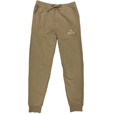 Sand colored sweatpants with elastic waistband and drawstring with ribbed ankle cuffs with The Glass City embroidered in cream thread on left leg below pocket.