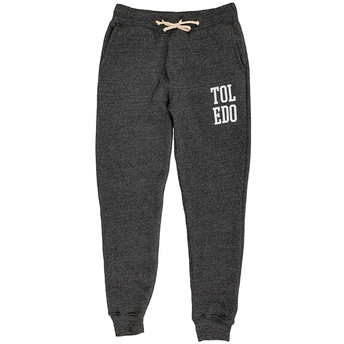 Dark heather gray slim fit jogger-style sweatpants with cream colored drawstring at waistband and an all caps white TOLEDO print on the left thigh at pocket line.