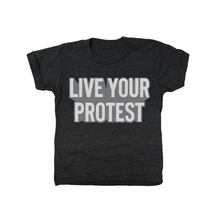 "Heather black youth short sleeved t-shirt with ""Live Your Protest"" in white with gray shadow in center chest."