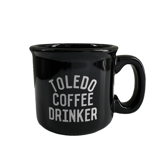 Black mug with beige Toledo Coffee Drinker design