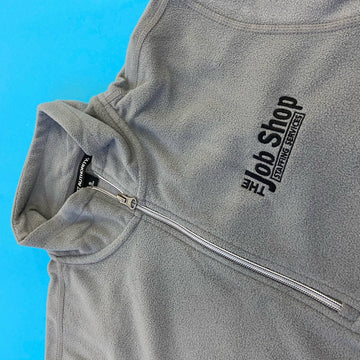 gray embroidered 1/4 zip that say the Job Shop