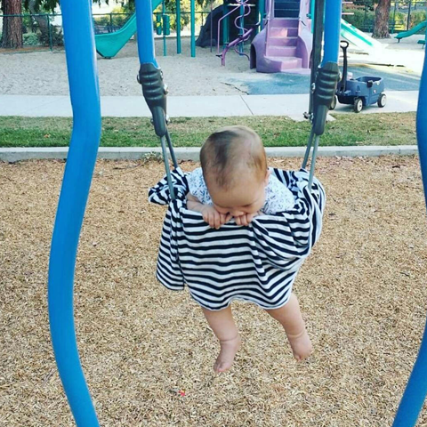 Baby on swing with cover