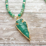 Seafoam veined glass beads accented with a 14k gold edged druzy agate arrowhead pendant.