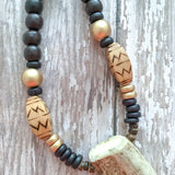 Dark espresso wooden beads accented with gold and natural wood, finished with a naturally-shed forked deer antler.
