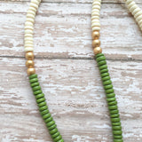 Creamy white and moss green wooden beads anchored with a 24k gold edged espresso Jasper arrowhead.
