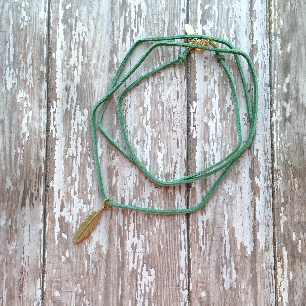 Triple wrap green suede leather choker finished with a shiny gold feather pendant.