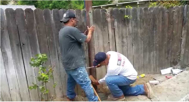 People showing how to fix a wood fence