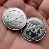 "Two ""No"" Symbol ""Fucks"" coins in hand"