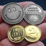 smiley face coin and 2 cents coins in hand