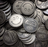 middle finger coins, stack of coins, smiley face coins