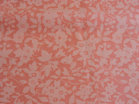 Liberty fabric, daisy shadow in coral, sold by frills and froth