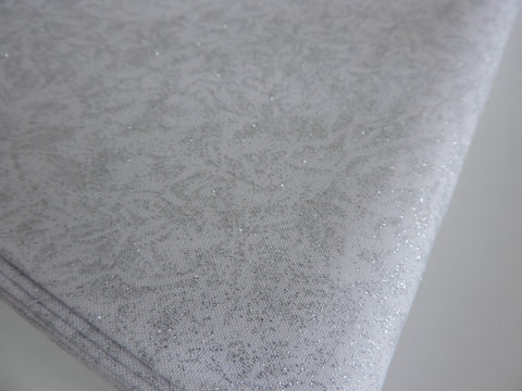 Michael Miller Fairy Frost fabric 'Zirconium' A white quilting weight 100% cotton fabric, with a metallic silver pattern. Suitable for making apparel, bunting, cushions, quilts etc.  More colour ways available in my Michael Miller Fairy Frost fabric section. 100% cotton fabric 112 cm wide Quilting/medium weight. Sold by the half metre and metre. sold by UK Michael Miller fabric stockist Frills and Froth. seller of designer fabric from Michael Miller, Riley Blake and Liberty