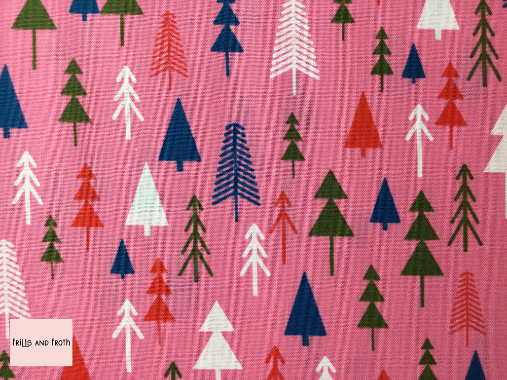 Dashwood Studio 'Merry and Bright' Christmas Trees quilting fabric Dashwood Studio 'Christmas Trees' from the Merry & Bright collection features trees in various sizes, colours and style on a pink background.