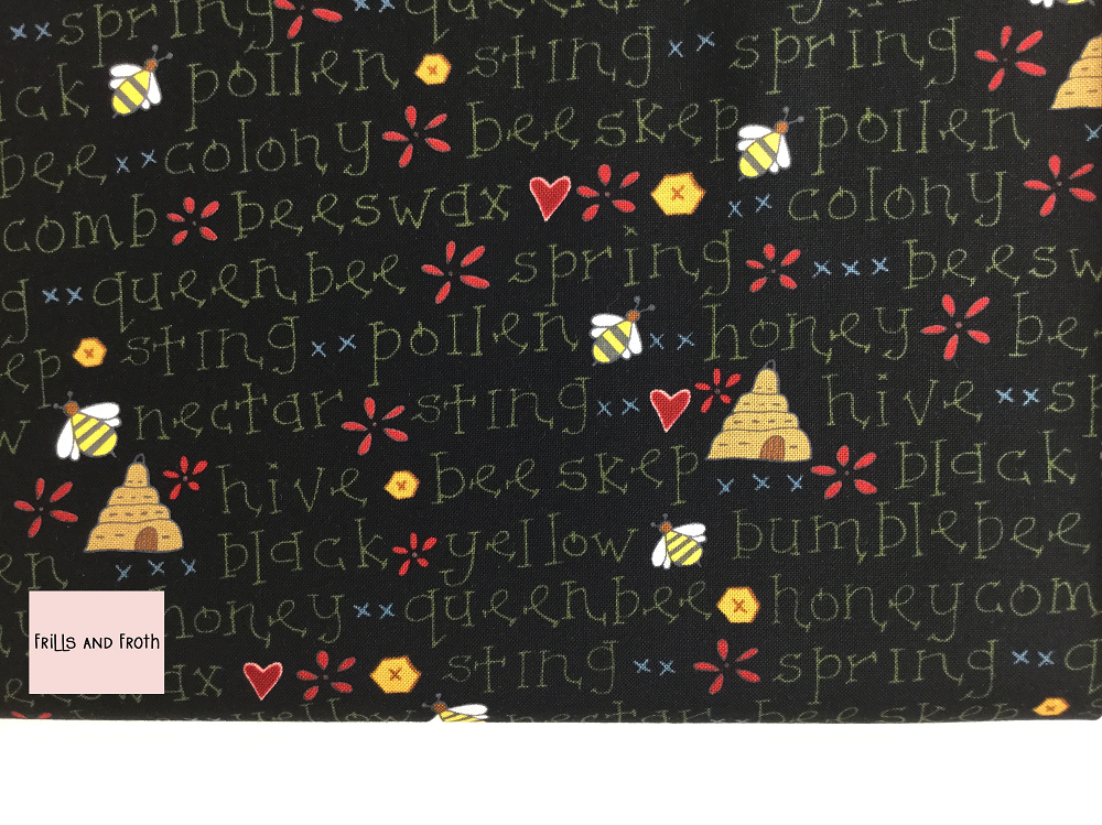 Henry Glass 'All About The Bees' 'Bee Words' quilting fabric This quilting fabric from the 'All About the Bees' collection by Henry Glass features bees, Hives and bee inspired words on black background.