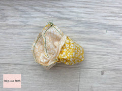 Turning my Liberty fabric pumpkin right side out after sewing it together.