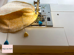 Image of the liberty fabric pumpkin segments being sewn together.