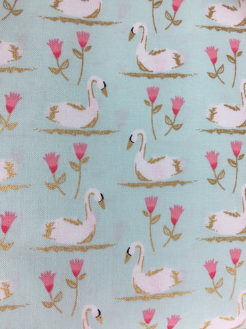 Michael Millers 'Swans a Swimming' fabric from Michael Miller fabrics! Featuring cute swans with metallic gold detailing, swimming between pink flowers on a beautiful pale blue background. . Michael Miller fabrics are 100% cotton and in quilting weight, this is perfect for all different sewing crafts from dressmaking to quilts from bunting to aprons! 100% cotton fabric 112 cm wide Quilting/medium weight. Sold by the half metre and metre. sold by UK Michael Miller fabric stockist Frills and Froth. seller of designer fabric from Michael Miller