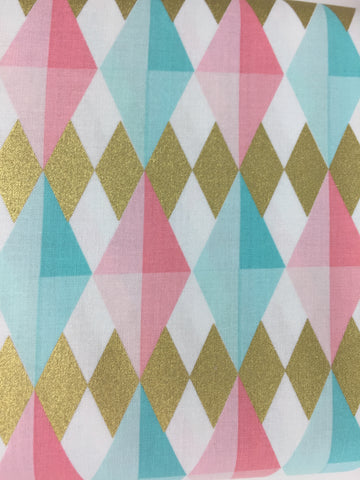 Michael Miller 'Diamond l'il' fabric. A 100% cotton fabric in quilting weight. This Michael Miller 'Diamond l'il' fabric features a bold and bright diamond geometric print in turquoise, pinks, whites and metallic gold. 100% cotton fabric 112cm wide Quilting/medium weight. Sold by the half metre and metre.sold by UK Liberty of London fabric stockist Frills and Froth. seller of designer fabric from Liberty, Michael Miller and Riley Blake