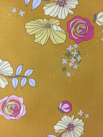 Michael Miller 'Moonbloom' fabric. Medium weight cotton fabric from Michael Miller, A mustard background with a retro floral pattern. Perfect for dress making! 100% cotton fabric 112 cm wide Quilting/medium weight. Sold by the half metre and metre. sold by UK Michael Miller fabric stockist Frills and Froth. seller of designer fabric from Michael Miller, Riley Blake and Liberty
