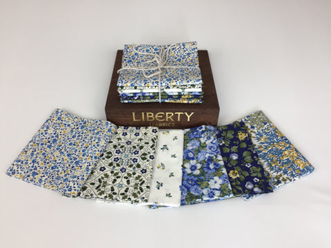 Liberty Fabric 'Orchard Garden' Fabric Fat Quarter Bundle in Blue. This bundle has six wonderful fabric fat quarters from the Liberty 'Orchard Garden' collection in blues and yellows. sold by UK Liberty of London fabric stockist Frills and Froth. seller of designer fabric from Liberty