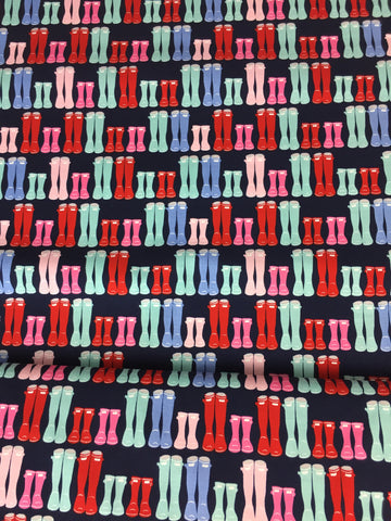 Riley Blake 'Fox Farm' wellington boot fabric.This fabric design features wellington boots in varying sizes, wellingtons in red, blue, pink and green on a navy blue background. Not just for quilting, this fabric is also suitable for dress making and home decor!    100% cotton fabric  112 cm wide  Quilting/medium weight  Sold by the half metre and metre.sold by UK Riley Blake fabric stockist Frills and Froth. seller of designer fabric from Riley Blake