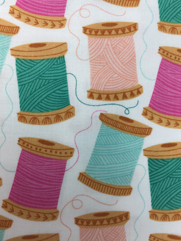 Dashwood Studio 'Cotton Reel' fabric A 100% cotton quilting weight fabric. This fabric from Dashwood Studio features bobbins in colours including orange, aqua and pink all on a white background. This fabric is suitable for dressmaking, quilting and home decor.   100% cotton fabric 112 cm wide Medium weight. Sold by the half metre and metre. sold by UK Liberty of London fabric stockist Frills and Froth. seller of designer fabric from Dashwood Studio