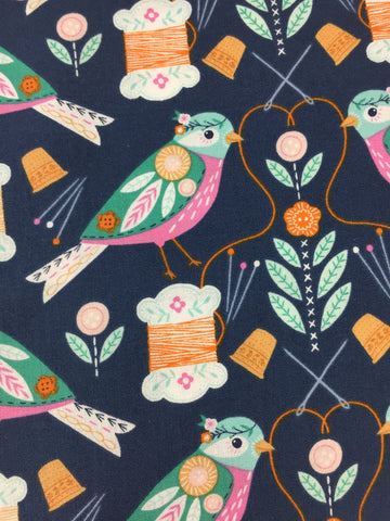 Dashwood Studio 'Birds and Bobbins' fabric. A 100% cotton quilting weight fabric. This fabric from Dashwood Studio features birds, thread, needles and more in colours including orange, aqua and pink all on a navy background. This fabric is suitable for dressmaking, quilting and home decor.   100% cotton fabric 112 cm wide Medium weight. Sold by the half metre and metre.sold by UK Liberty of London fabric stockist Frills and Froth. seller of designer fabric from Dashwood Studio