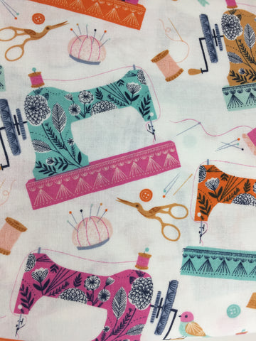 Dashwood Studio 'Sewing Machine' fabric. A 100% cotton quilting weight fabric. This stunning fabric from Dashwood Studio features sewing machines, scissors, pin cushions and more in colours including orange, aqua and pink all on a white background. This fabric is suitable for dressmaking, quilting and home decor.   100% cotton fabric 112 cm wide Medium weight. Sold by the half metre and metre. sold by UK Liberty of London fabric stockist Frills and Froth. seller of designer fabric from Dashwood Studio