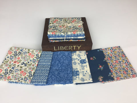 Liberty Fabric 'Cottage Garden' Fabric Fat Quarter Bundle in Blue. This bundle has six iconic fabric fat quarters from the Liberty 'Cottage Garden' collection in Blue. sold by UK Liberty of London fabric stockist Frills and Froth. seller of designer fabric from Liberty
