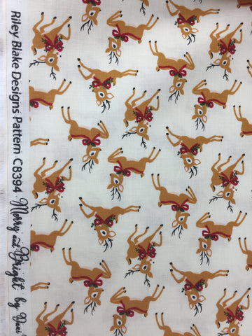 Riley Blake 'Merry and Bright' reindeer fabric, This festive fabric features prancing reindeer on an white background. This would make the perfect festive sewing project!  Coordinates with 'Merry and Bright' advent panel fabric.    100% cotton fabric  112 cm wide.   Quilting/medium weight   Sold by the half metre and metre. sold by UK Riley Blake fabric stockist Frills and Froth. seller of designer fabric from Riley Blake