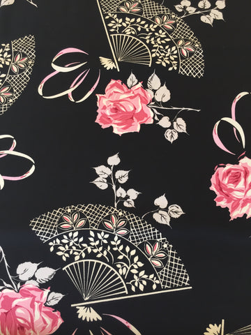 Michael Miller 'Gertie' fabric 'Temptress' in black. A 100% cotton medium weight fabric. Designed by Gretchen 'Gertie' Hirsch for Michael Miller part of the 'Boudoir' collection. This fabric features fans and flowers pink and white on a black background. 100% cotton fabric 112 cm wide Quilting/medium weight. Ideal for dressmaking, quilting and other fabric crafts. sold by UK Michael Miller fabric stockist Frills and Froth. seller of designer fabric from Michael Miller