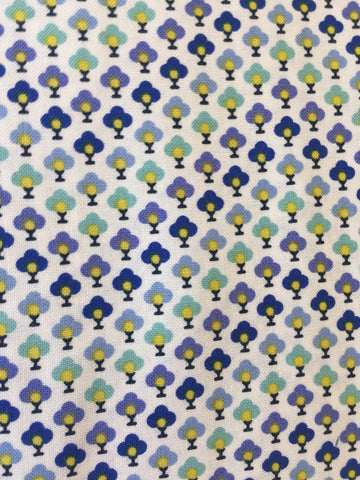 Liberty 'Chevron' fabric. A 100% cotton fabric in quilting weight. This Liberty 'Chevron'  fabric from The Summer House collection features a small repeating topiary pattern in blue's and green on a white background. Not just for quilting, this fabric is also suitable for dressmaking and home decor.   100% cotton fabric 112 cm wide Quilting/medium weight. sold by UK Liberty of London fabric stockist Frills and Froth. seller of designer fabric from Liberty, Michael Miller and Riley Blake
