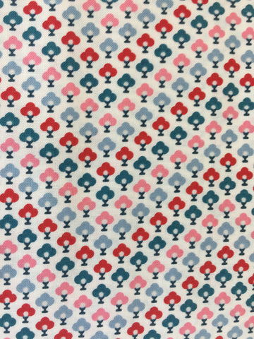 Liberty 'Chevron' fabric. A 100% cotton fabric in quilting weight. This Liberty 'Chevron'  fabric from The Summer House collection features a small repeating topiary pattern in red, blue, pink and green on a white background. Not just for quilting, this fabric is also suitable for dressmaking and home decor.   100% cotton fabric 112 cm wide Quilting/medium weight. sold by UK Liberty of London fabric stockist Frills and Froth. seller of designer fabric from Liberty, Michael Miller and Riley Blake