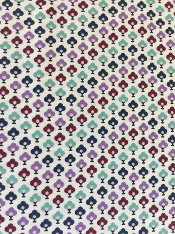 Liberty 'Chevron' fabric. A 100% cotton fabric in quilting weight. This Liberty 'Chevron'  fabric from The Summer House collection features a small repeating topiary pattern in lavender, blue,red and green on a white background. Not just for quilting, this fabric is also suitable for dressmaking and home decor.   100% cotton fabric 112 cm wide Quilting/medium weight. sold by UK Liberty of London fabric stockist Frills and Froth. seller of designer fabric from Liberty, Michael Miller and Riley Blake