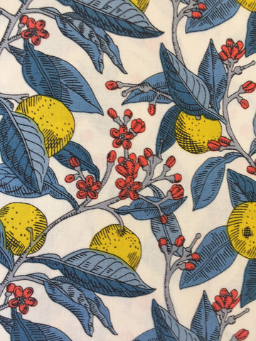 Liberty 'Conservatory Fruit's' fabric. A 100% cotton fabric in quilting weight. This Liberty 'Conservatory Fruit's' fabric from The Summer House collection features a bold fruit and vine design in yellow with blues and reds on a white background. Not just for quilting, this fabric is also suitable for dressmaking and home decor.   100% cotton fabric 112 cm wide Quilting/medium weight. sold by UK Liberty of London fabric stockist Frills and Froth. seller of designer fabric from Liberty, Michael Miller and Riley Blake
