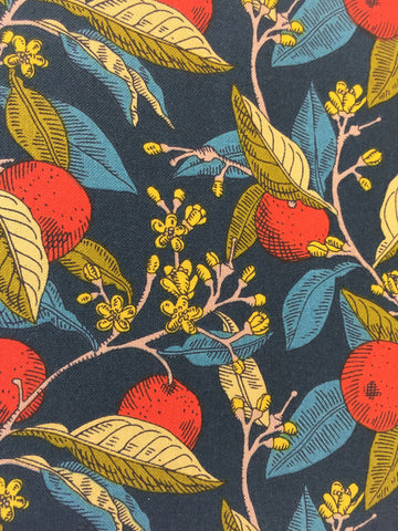 Liberty 'Conservatory Fruit's' fabric. A 100% cotton fabric in quilting weight. This Liberty 'Conservatory Fruit's' fabric from The Summer House collection features a bold fruit and vine design in red with yellow,blues and reds on a dark blue background. Not just for quilting, this fabric is also suitable for dressmaking and home decor.   100% cotton fabric 112 cm wide Quilting/medium weight. sold by UK Liberty of London fabric stockist Frills and Froth. seller of designer fabric from Liberty, Michael Miller and Riley Blake
