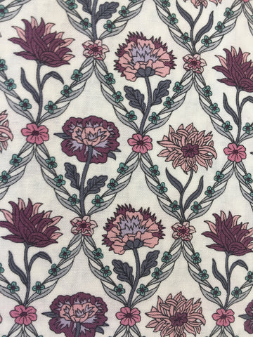 Liberty 'Kew Trellis' fabric. A 100% cotton fabric in quilting weight. This Liberty 'Kew Trellis' fabric from The Summer House collection features a elegant floral trellis pattern in rose on a cream background. Not just for quilting, this fabric is also suitable for dressmaking and home decor.   100% cotton fabric 112 cm wide Quilting/medium weight sold by UK Liberty of London fabric stockist Frills and Froth. seller of designer fabric from Liberty, Michael Miller and Riley Blake.