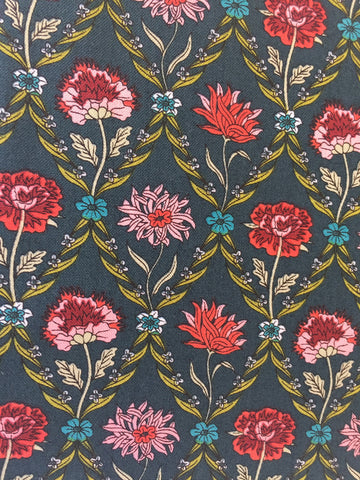 Liberty 'Kew Trellis' fabric. A 100% cotton fabric in quilting weight. This Liberty 'Kew Trellis' fabric from The Summer House collection features a elegant floral pattern in pink, red and blue on a dark green background. Not just for quilting, this fabric is also suitable for dressmaking and home decor.   100% cotton fabric 112 cm wide Quilting/medium weight.sold by UK Liberty of London fabric stockist Frills and Froth. seller of designer fabric from Liberty, Michael Miller and Riley Blake