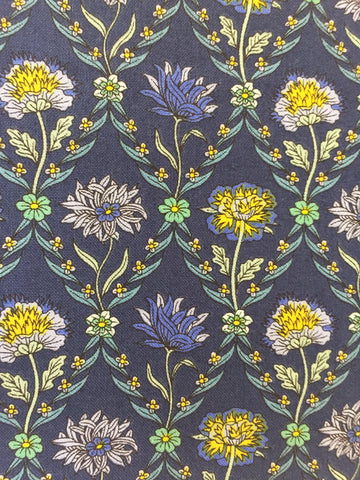 Liberty 'Kew Trellis' fabric. A 100% cotton fabric in quilting weight. This Liberty 'Kew Trellis' fabric from The Summer House collection features a elegant floral pattern in blue and yellow on a navy background. Not just for quilting, this fabric is also suitable for dressmaking and home decor.   100% cotton fabric 112 cm wide sold by UK Liberty of London fabric stockist Frills and Froth. seller of designer fabric from Liberty, Michael Miller and Riley Blake