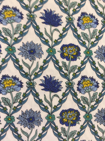 Liberty 'Kew Trellis' fabric. A 100% cotton fabric in quilting weight. This Liberty 'Kew Trellis' fabric from The Summer House collection features a elegant floral pattern in blue and yellow on a white background. Not just for quilting, this fabric is also suitable for dressmaking and home decor.   100% cotton fabric 112 cm wide Quilting/medium weight.sold by UK Liberty of London fabric stockist Frills and Froth. seller of designer fabric from Liberty, Michael Miller and Riley Blake