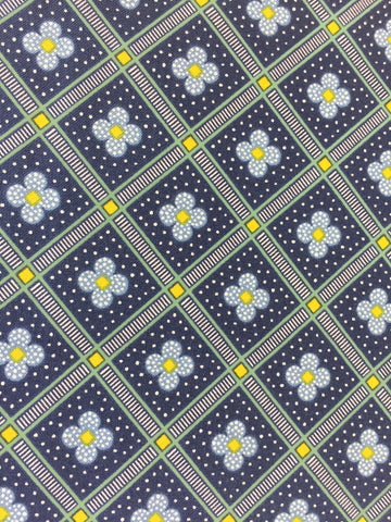 Liberty 'Manor Tiles' fabric. A 100% cotton fabric in quilting weight. This Liberty 'Manor Tiles' fabric from The Summer House collection features a elegant floral tile pattern on a navy background. Not just for quilting, this fabric is also suitable for dressmaking and home decor. sold by UK Liberty of London fabric stockist Frills and Froth. seller of designer fabric from Liberty, Michael Miller and Riley Blake