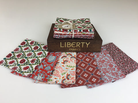 Liberty Fabric 'Summer House' Fabric Fat Quarter Bundle in Red and Pink This bundle has six iconic fabric fat quarters from the Liberty 'Summer House' collection in Red and Pink. sold by UK Liberty of London fabric stockist Frills and Froth. seller of designer fabric from Liberty