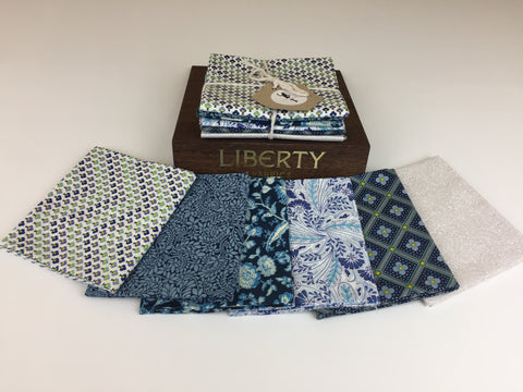 Liberty Fabric 'Summer House' Fabric Fat Quarter Bundle in Blue. This bundle has six iconic fabric fat quarters from the Liberty 'Summer House' collection in Blue. sold by UK Liberty of London fabric stockist Frills and Froth. seller of designer fabric from Liberty
