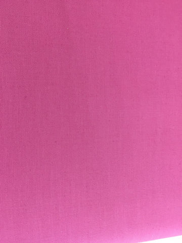 Robert Kaufman 'Kona' fabric in 'Candy Pink' A 100% cotton fabric in medium weight. This wonderful fabric from Robert Kaufman is a Candy Pink colour fabric. This fabric is suitable for dressmaking, quilting and home decor. sold by Robert Kaufman fabric stockist Frills and Froth. seller of designer fabric from Robert Kaufman fabric