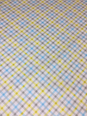 Michael Miller 'Tiny Tots' fabric 'Baby Plaid' in blue. Part of the Michael Miller 'Tiny Tots' collection this 100% cotton fabric features a plaid pattern design in blue and grey shades with yellow on a white background. sold by UK Michael Miller fabric stockist Frills and Froth. seller of designer fabric from Michael Miller,