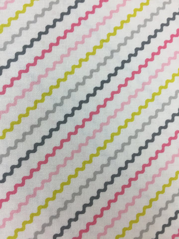 Michael Miller 'Tiny Tots' fabric 'Rick Rack' in pink. Part of the Michael Miller 'Tiny Tots' collection this 100% cotton fabric features a rick rack inspired pattern design in pink and grey shades with yellow on a white background. sold by UK Michael Miller fabric stockist Frills and Froth. seller of designer fabric from Michael Miller,