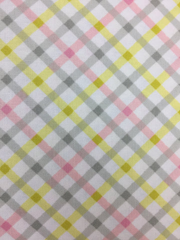 Michael Miller 'Tiny Tots' fabric 'Baby Plaid' in pink. Part of the Michael Miller 'Tiny Tots' collection this 100% cotton fabric features a plaid pattern design in pink and grey shades with yellow on a white background.